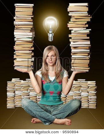 Woman In Lotus Pose With Many Books In Her Hands And Bulb