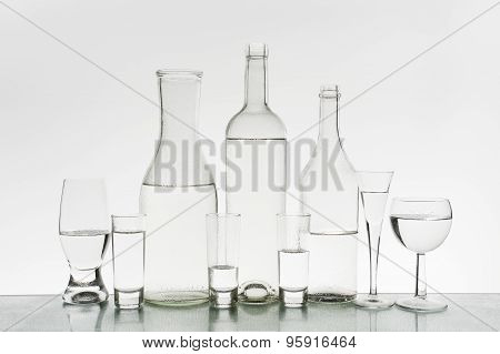 Glassware With Water On The Light Background