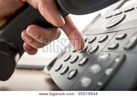 Closeup Of Dialing A Telephone Number On A Black Landline Telephone