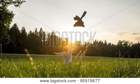 Happy Businessman At The Field Throwing His Coat