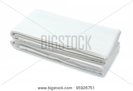 Stack of white folded bedding isolated on white