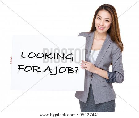 Businesswoman present on white board with phrase of looking for a job