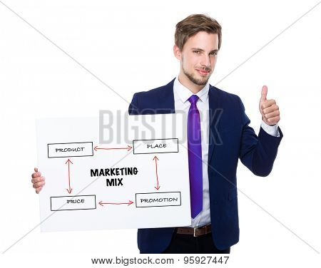 Businessman with thumb up gesture and holding placard showing of marketing mix concept