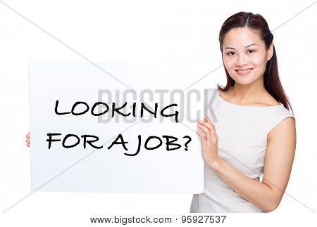 Woman holding with white poster presenting phrase of looking for a job