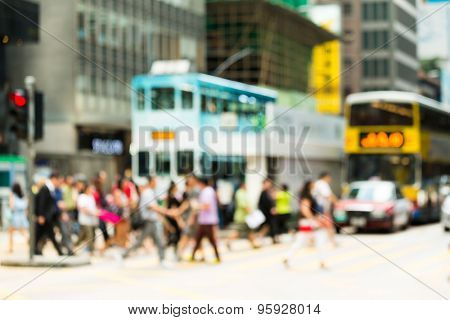 Blurred view of the pedestrian crossing the road