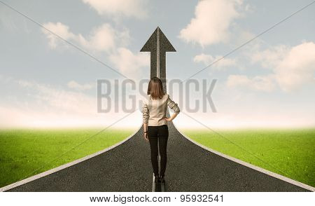 Business woman lokking at 3d road with up arrow concept