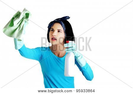 Portrait of happy woman with a cleaning fluid.