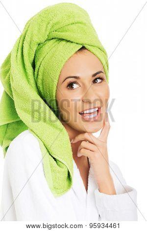 Happy woman in bathrobe and towel on head.