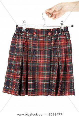 Feminine Hand Keeps Plaid Skirt