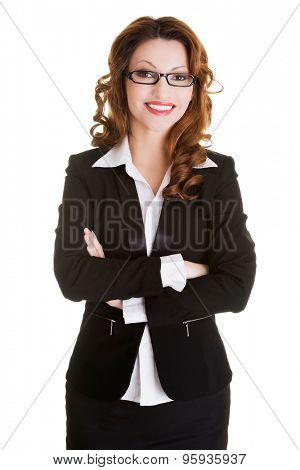 Beautiful smiling businesswoman with folded arms.