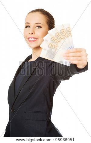 Business woman showing euro currency money banknotes.