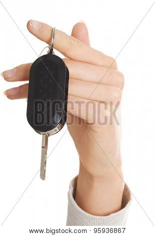 Close up on female hand holding a car key.
