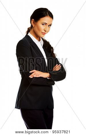 Confident businesswoman standing with folded arms.