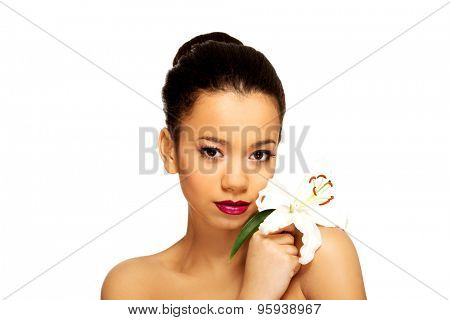 Beauty face of african woman with lily flower.