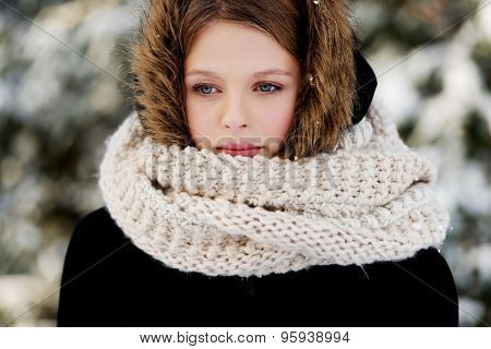 Teenage woman in winter clothes outdoor