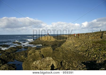 Tourists At The Giants Causeway