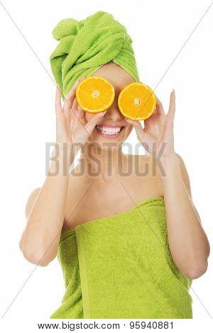 Beautiful woman with orange on eyes.