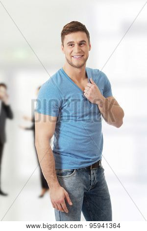Casual young fashionable man smiling to camera.