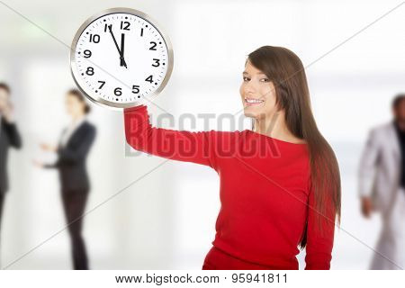 Young happy student woman with the clock.