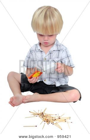 Young Boy Playing With Matches On A White Background