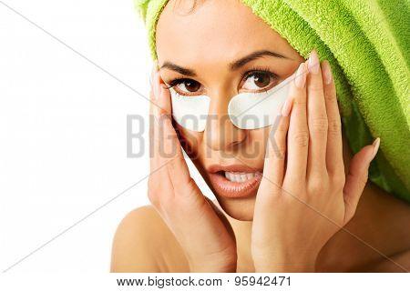 Spa serene woman with gel eye mask