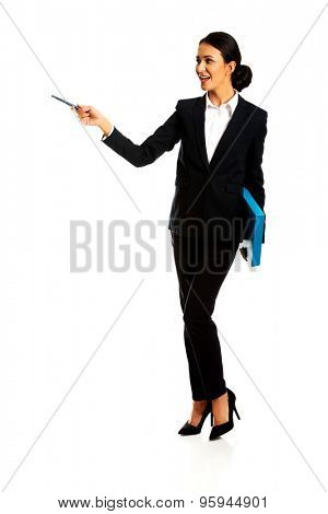 Smiling businesswoman holding a pen and binder.