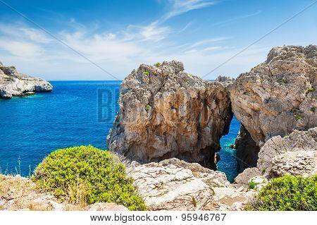 Beautiful Wild Beach With Unusual Rocks At The Sea Coast