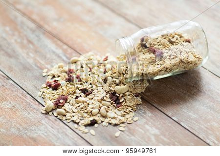 food, healthy eating and diet concept - close up of jar with granola or muesli on table