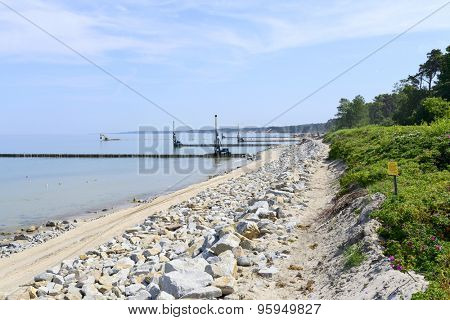 Workers build a breakwater to facilitate the construction of the beach in Ustka, Poland.