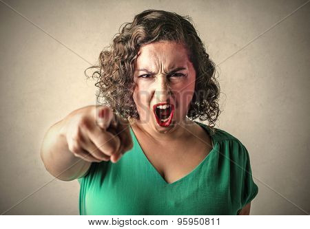 Angry woman judging someone