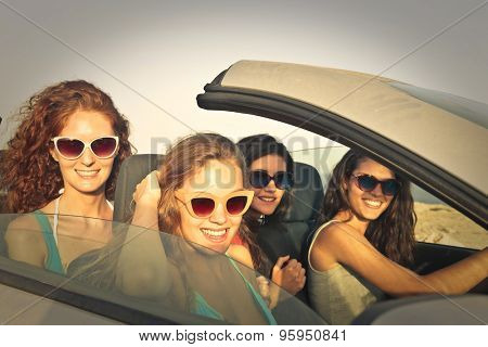 Girls on vacation driving a car