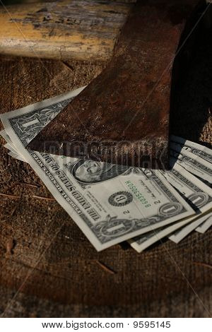 Dollar Bills Under Sharp Old Axe
