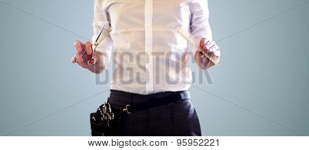 beauty and hair salon, hairstyle and people concept - close up of male stylist with scissors and comb over blue background