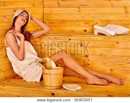Young woman looking up in sauna.