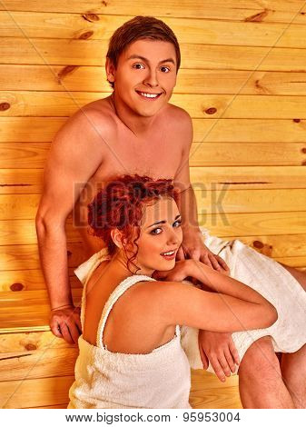 Young loving  couple  relaxing at sauna.