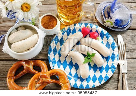 Traditional Bavarian meal. White sausage with sweet mustard and pretzel