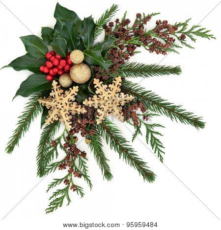 Christmas flora with gold snowflake and sparkly baubles, holly with red berries and winter greenery over white background.
