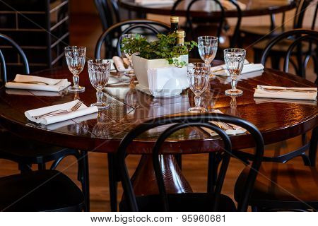 Wooden round table served for dinner in the restaurant