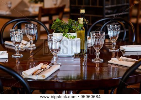 Tableware On Wooden Table In Restaurant
