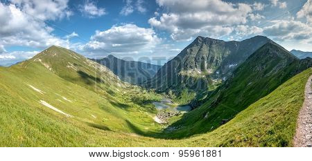Wonderful Valley In Summer Mountains With The Surrounding Peaks