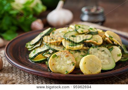 Warm salad with young zucchini with garlic and herbs