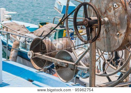 Metal Rusted Hose Reels On Fishing Boat