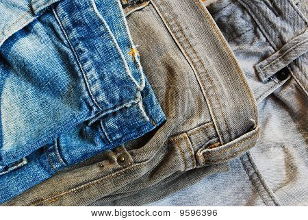 Three Color Jeans Pile Background Picture