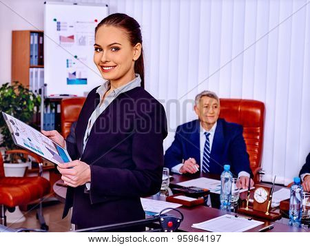 Happy group business people woman and man with chart in office.