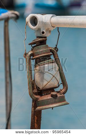 Old Rusted Lamp On A Fishing Boat.