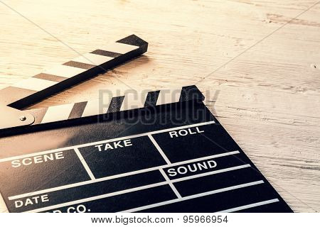 Film camera chalkboard placed on wooden table