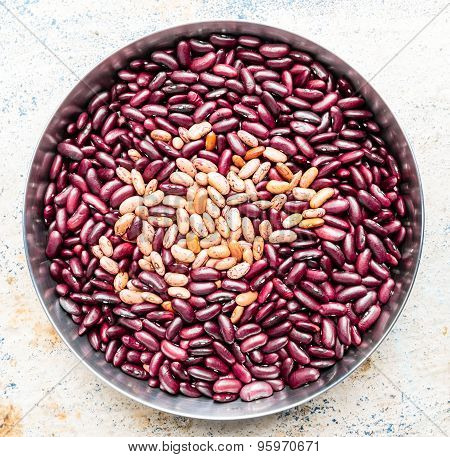 Kidney beans kept on a plate on a plain background