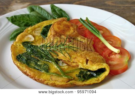 Omelet with eggs, potatoes and spinach