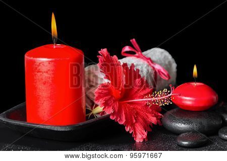Beautiful Spa Still Life Of Red Hibiscus Flower With Dew, Candles And White Rolled Towel On Zen Ston