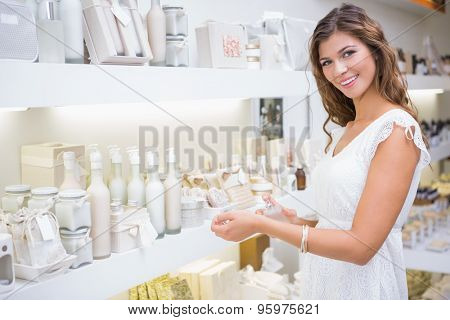 Portrait of smiling woman testing perfume at a beauty salon